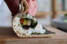 Demuths photography workshop - Sushi being rolled with a wooden matt.