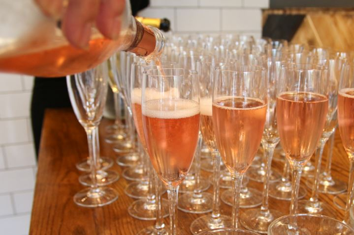 Bomboloni - Bristol restaurant launch. Wine being poured into glasses for the launch party.
