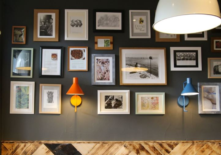 Bomboloni - Bristol restaurant launch. Bomboloni interior - pictures an lighting on a wall.
