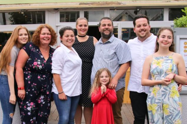 Bomboloni - Bristol restaurant launch. Andrew and Molly Griffin with their family in front of the restaurant.