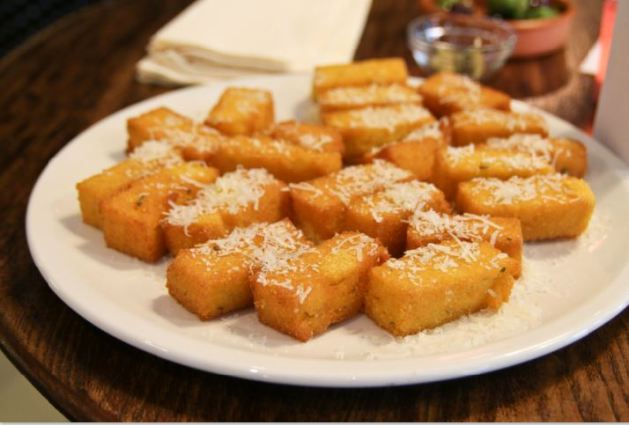 Bomboloni - Bristol restaurant launch. Polenta chips with Parmesan being served at the launch party.