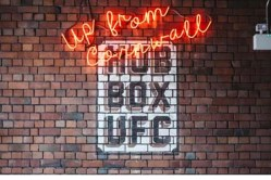Up from Cornwall Hub Box U F C sign. Interior of Hubbox Bristol