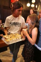 Staff serving dirty fries on a tray at the Hubbox Bristol launch