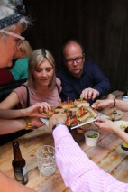 Bloggers and journalists enjoying burgers at the Hubbox Bristol launch